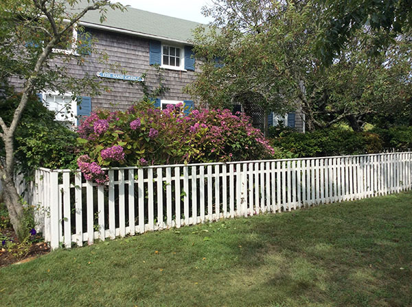 Nantucket House in front of the white fence